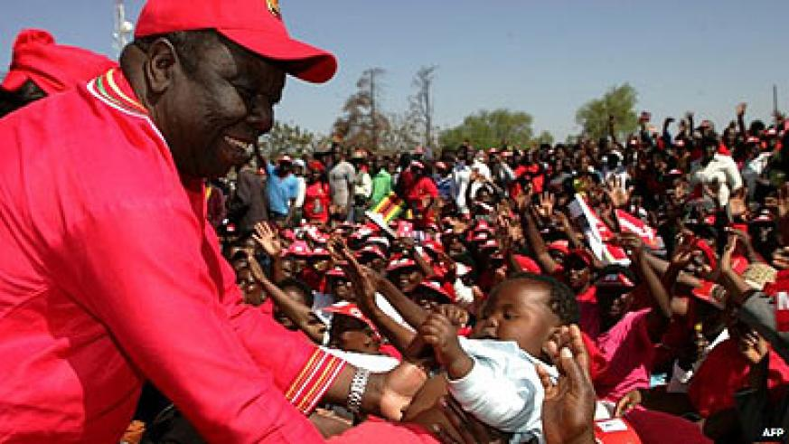 Morgan Tsvangirai during one of his campaign meetings. Tsvangirai's private life and marriage to Elizabeth Macheka (inset) has become an election issue. Net photos.
