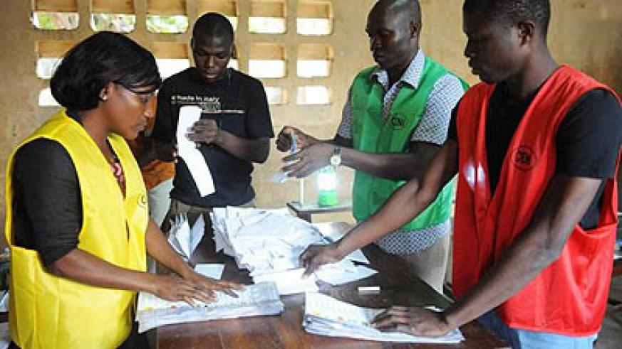Members of Togo's Independent National Electoral Commission (CENI) sort out valid votes on July 25, 2013 in Lome, during the country's parliamentary elections. Togo's ruling party has ....