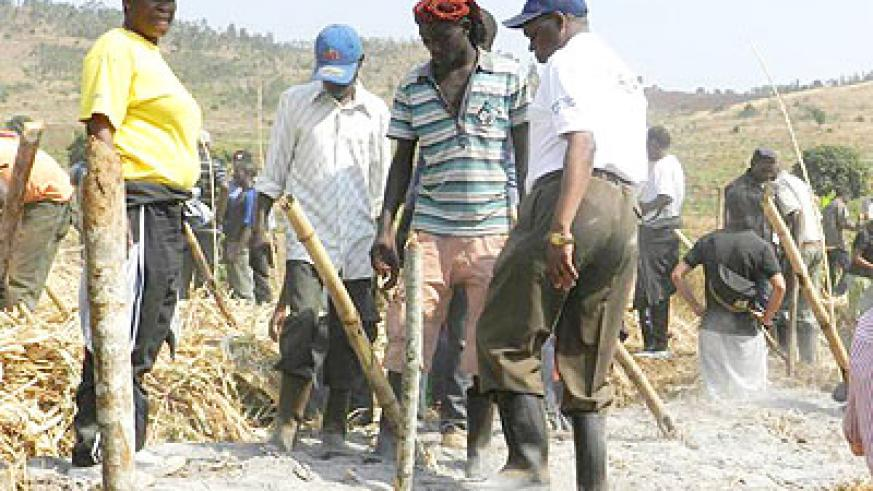 Local leaders engage farmers in use of manure gardens. The New Times/ S. Rwembeho.