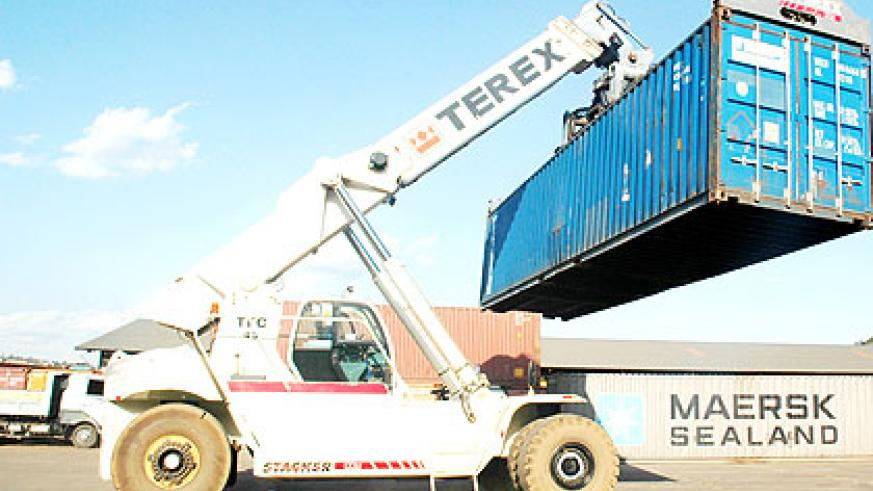 A crane moves a goods container at Magerwa container terminal. Efficient recovery of tax arrears and internally designed tax administration and collection measures have ensured improve....
