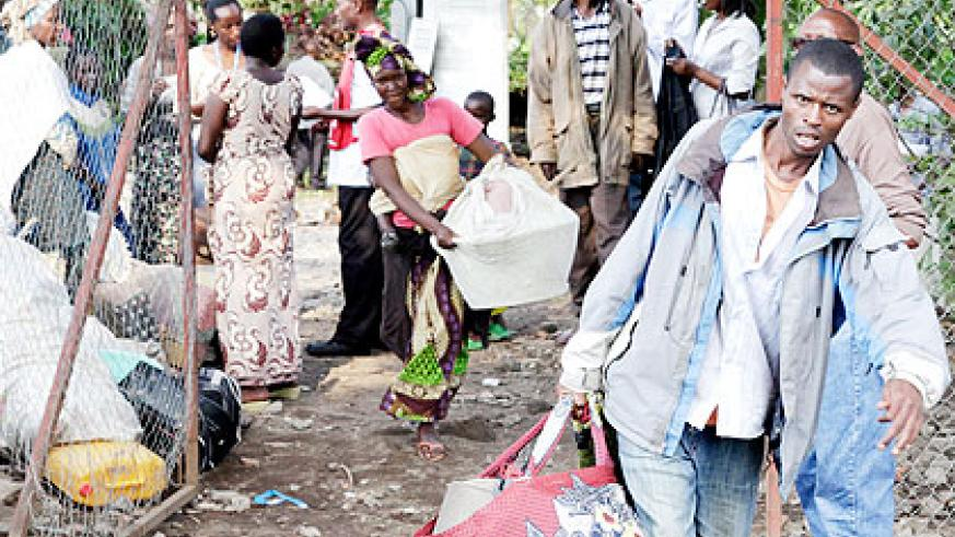 Congolese refugees prepare to board a lorry at Goma to Nyakamira transit camp. The New Times/ File.