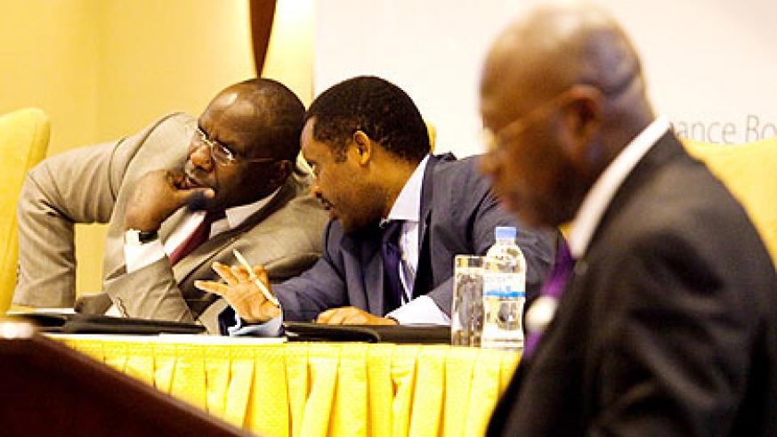 Manneh (R) gives his remarks as Shyaka (L) consults with Prime Minister Pierre Damien Habumuremyi.    The New Times/ Timothy Kisambira.