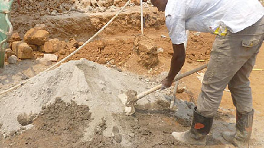 A worker mixes sand and cement at a construction site in Kigali. RBS has started a drive to sensitise the public about standards of products, including building materials. The New Times/File