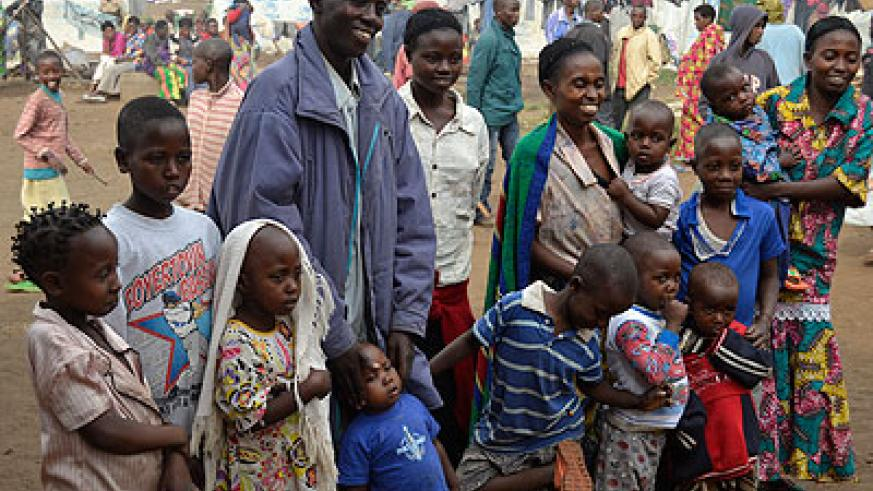 Singirankabo with his wide family immediately after returning home. BELOW. Newly repatriated refugees talk to their colleagues at  Nkamira Transit Centre  The New Times/Jean d'Amour ....
