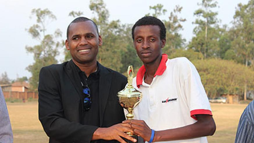 Kagarama's SS's Bryson Bugingo recieving his Man of the Tournament award from RNOC vice president Elie Mani. Times Sport / Courtesy