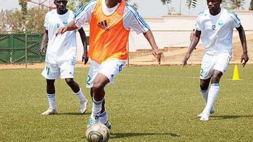 Patrick Sibomana (with the ball) has also been named on the U20 team for the Francophone Games. Saturday Sport/T. Kisambira.