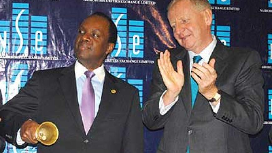 Umeme board chairman Patrick Bitature (left) and Chapman during the listing of the company's share at the NSE last year. Net photo