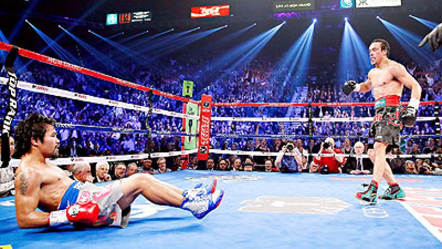 DOWN BUT NOT OUT; Pacquiao (on the floor) suffered a brutal sixth-round knockout by Juan Manuel Márquez (R) in December. Net photo.