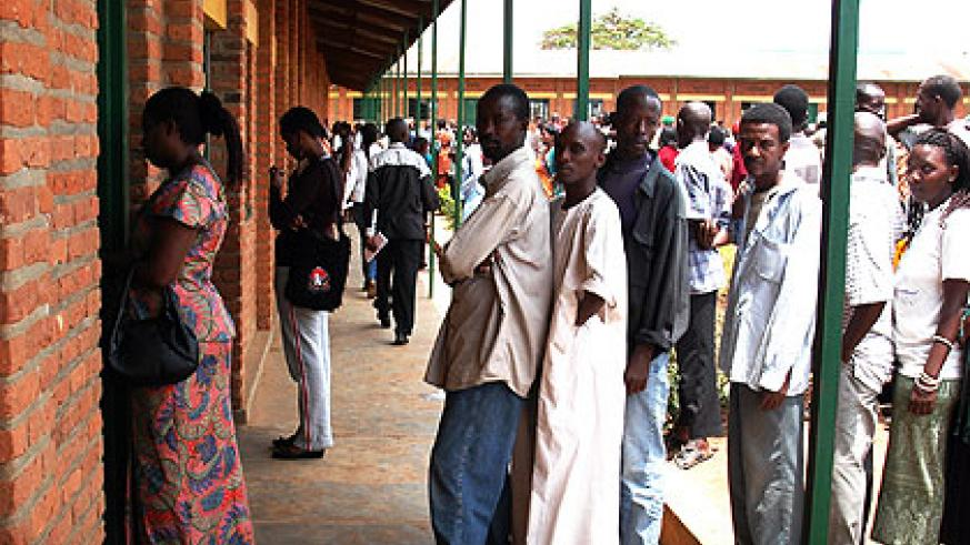 Voters during a previous election process.  Campaigns for candidates seeking to join parliament are scheduled to begin on August 26 and end on September 15.   The New Times/File.