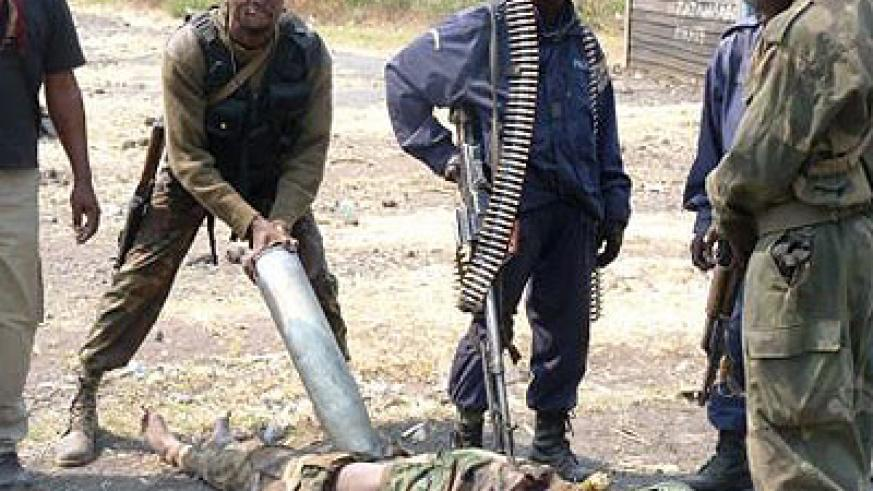 FARDC soldiers mutilating dead bodies of the 'enemy fighters'. Net photo.