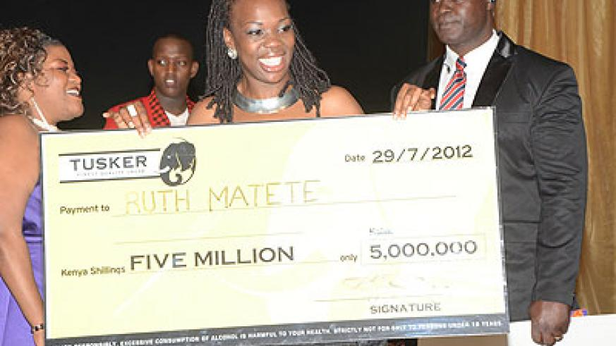 Last season's winner Ruth Matete poses with the Ksh5M from the sponsors East African Breweries. Net photo.