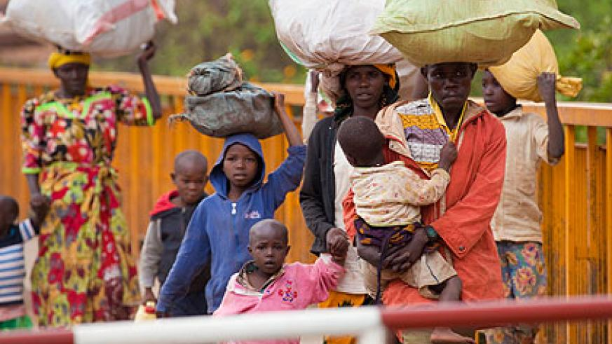 A Rwandan family returns from Tanzania yesterday. Many Rwandans crossed the Rusumo border on the final day of the deadline set by the Tanzanian governent.   Saturday Times/ Timothy Kis....
