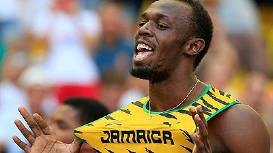 Usain Bolt celebrating after winning gold in Moscow. Net photo.