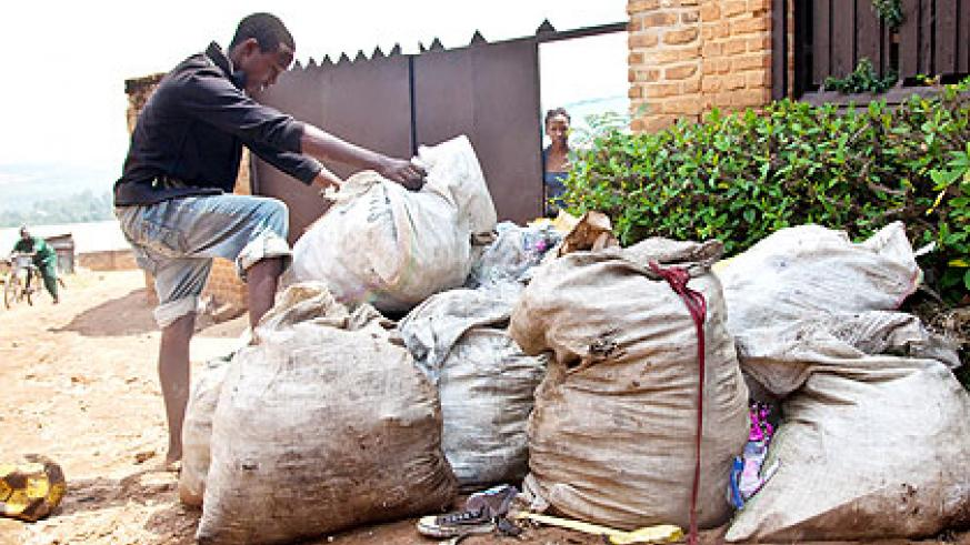 A boy dumps garbage in a neighbourhood in Kanombe Sector. The City of Kigali cleanness campaign seeks to have all households sort garbage before placing for disposable collection, besi....