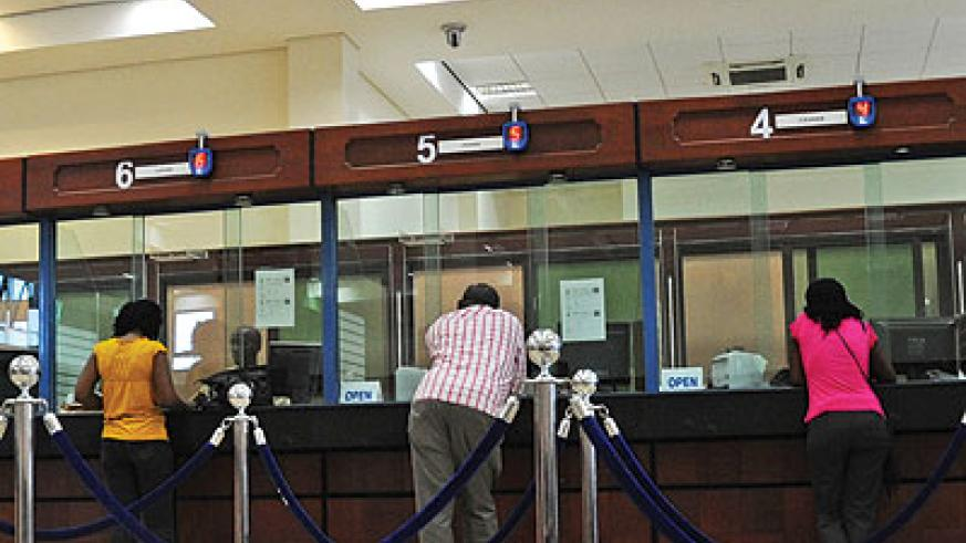 Bank customers being served. CRB has greatly helped banks detect would-be defaulters. The New Times / File
