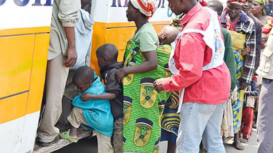 Congolese refugees board a bus to Mugunga camp during their repatriation yesterday. The New Times/ Jean Mbonyinshuti.