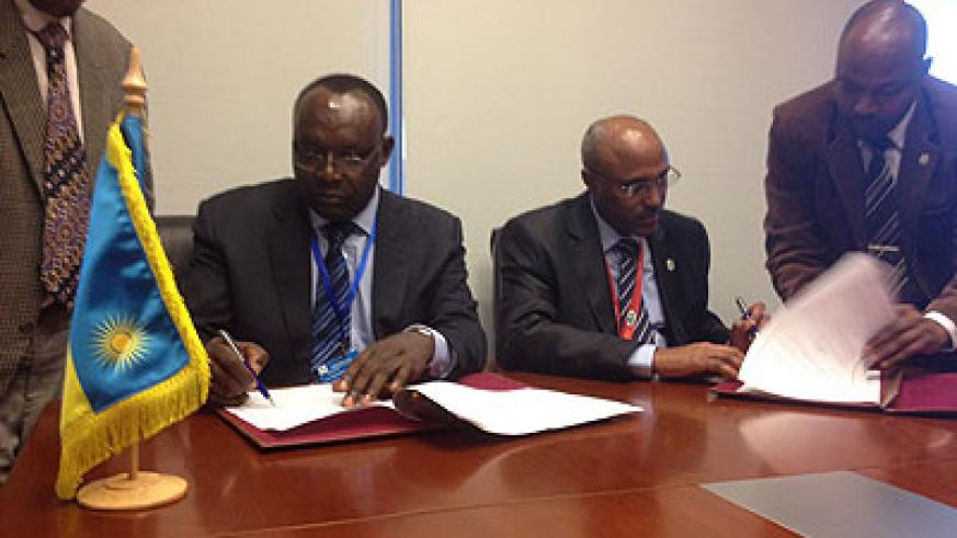 Trade and Industry minister  Kanimba (L) signs the agreement with Ethiopia's Chane. The New Times/Courtsey