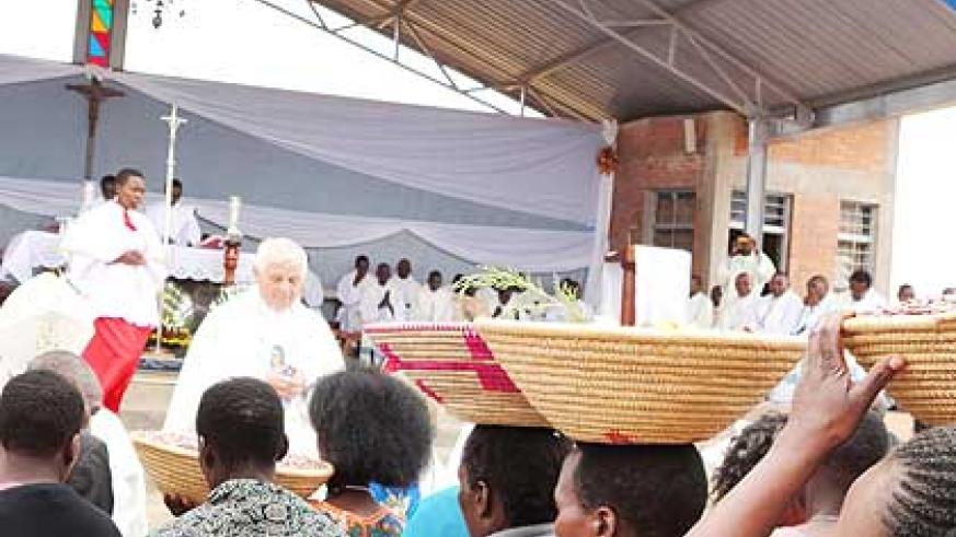 The faithful carry their offerings on Assumption Day at Kibeho Mary Mother of the Word in Nyaruguru District yesterday. Thousands of Catholic faithful from across the world flocked Kib....