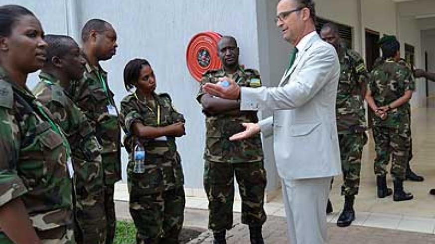Major General Patrick Cammaert chats with some of the trainees.  The New Times/Jean d'Amour Mbonyinshuti