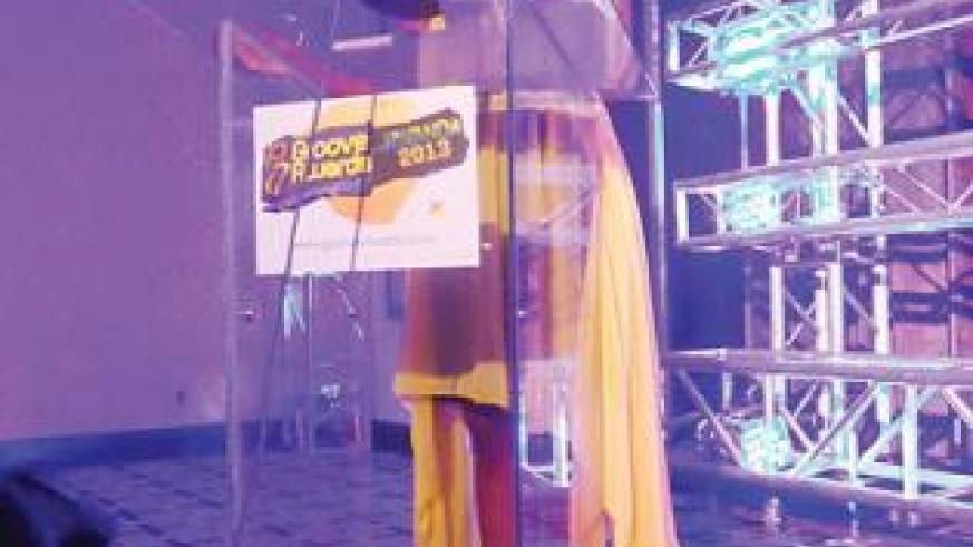 The manager of Groove Awards, Joy Wachira speaking during the event. The New Times / Susan Babijja.