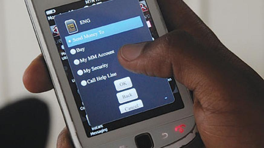Banks have looked to the mobile phone to strenghten their competitiveness . The New Times / John Mbanda