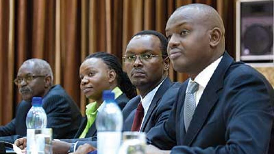 (L–R): RSA boss Binamungu, Monyatsi, Hategeka and Serge Guillaume, an advisor to the youth, sports and culture minister, listen to discussions at the workshop. The New Times / Timoth....