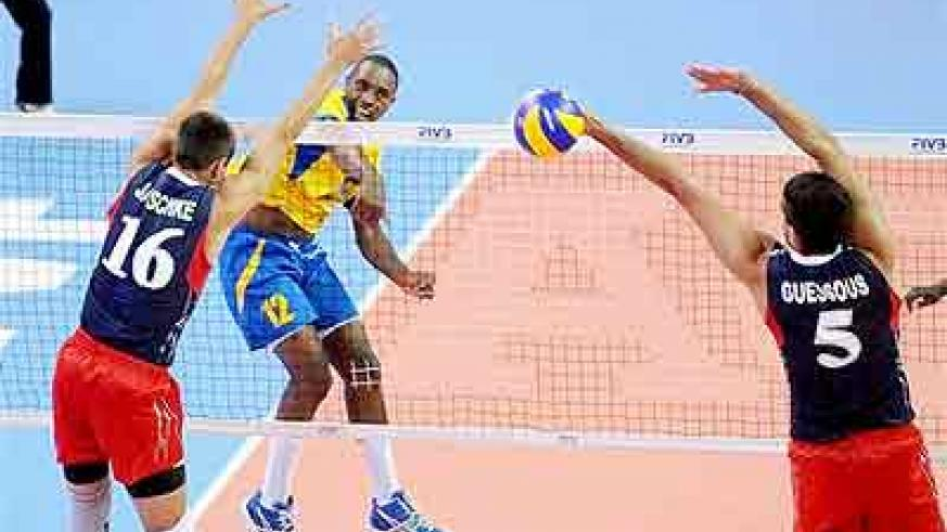 Rwanda's captain  Aimable Mutuyimana tries to score against US's Thomas Jaeschke and Driss Guessous block yesterday. Times Sport/ Courtesy.