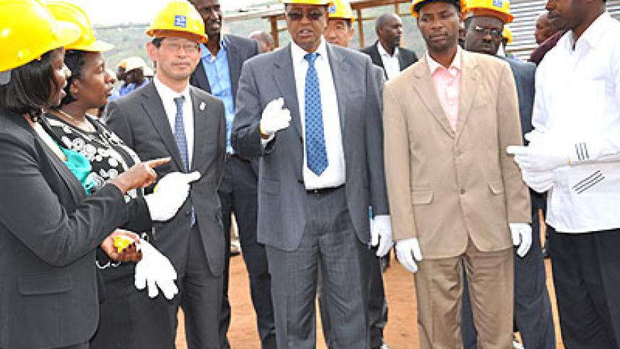 Prof. Lwakabamba (C), Amb. Ogawa (3rd L) and other officials at Musha electricity sub-station. The New Times S. Rwembeho.   The New Times/ Stephen Rwemb eho.