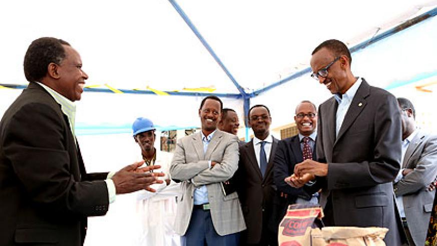 President Kagame discusses the benefits of storage facilities with Joseph Gafaranga, one of the farmers from across the country whose harvest have grown from a few hundred kilogrammes ....