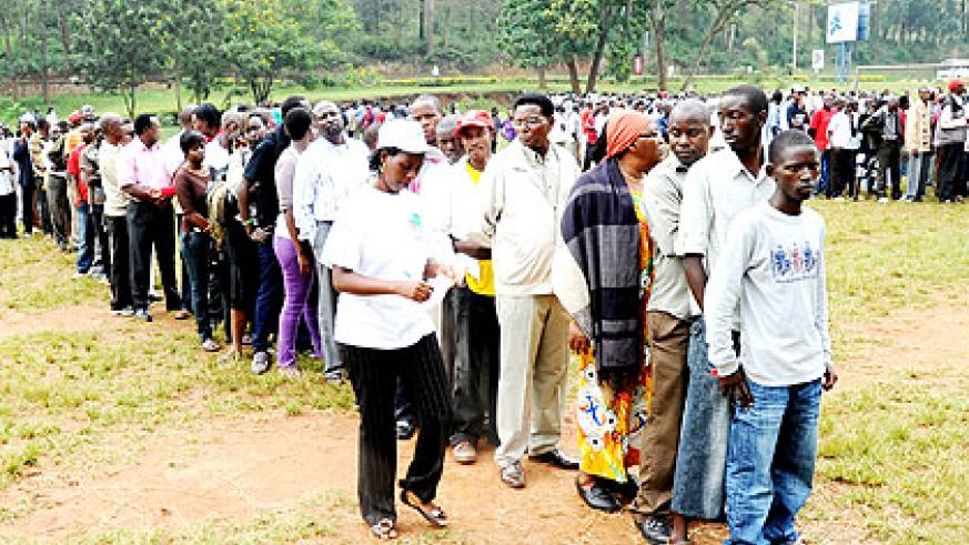 Voters wait to cast their ballot during a past election exercise. Women candidates say they have no money to canvass rallies.  The New Times/ File.