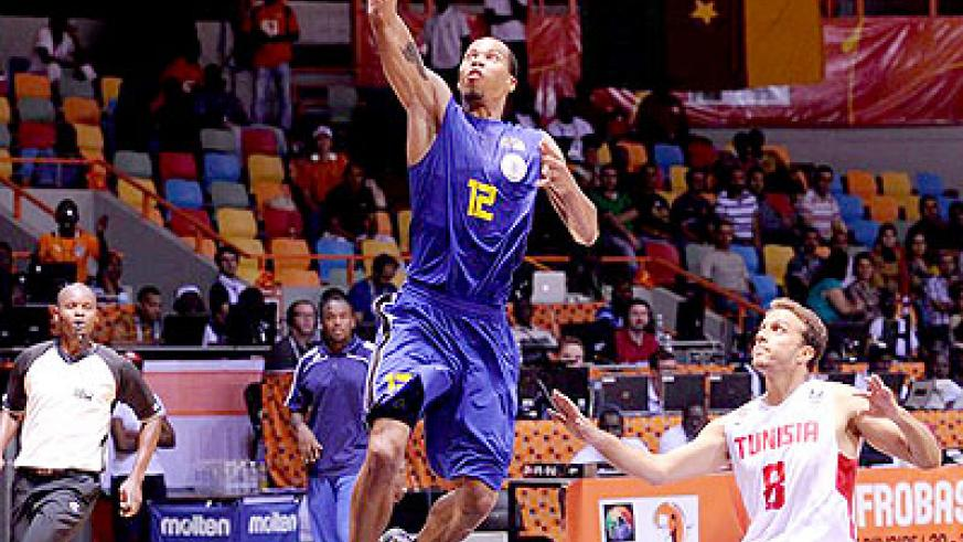 Rwanda's Kenneth Gasana scores against Tunisia. He is the top-scorer in the 2013 Afrobasket championship in Abidjan. The New Times / Courtesy.