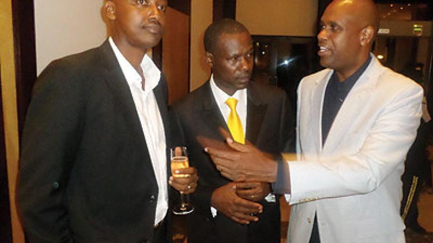 RwanAir CEO John Mirenge chats with other guests at the cocktail party. The New Times / Ivan Ngoboka