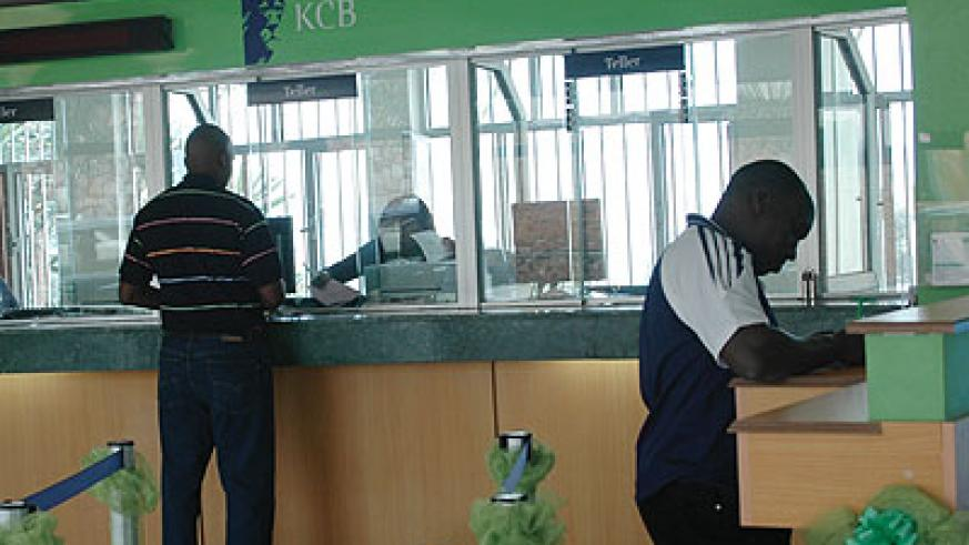 KCB Rwanda customers being served. The bank's bad loans increased. The New Times/File