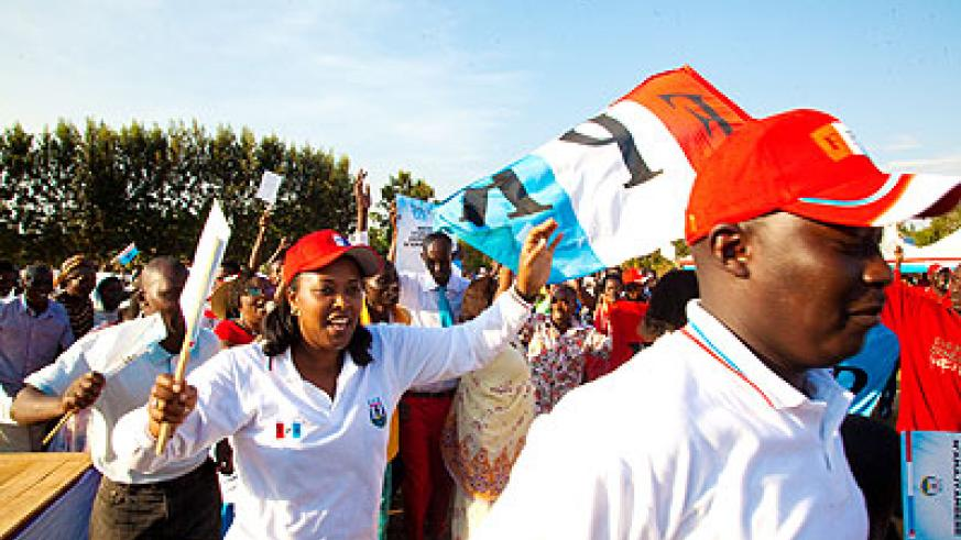 RPF-Inkotanyi supporters (above) jubilate at a rally in Masaka Sector in Kicukiro District on Wednesday. Below, the coalition parliamentary candidates campaign.  The New Times/ Tim....