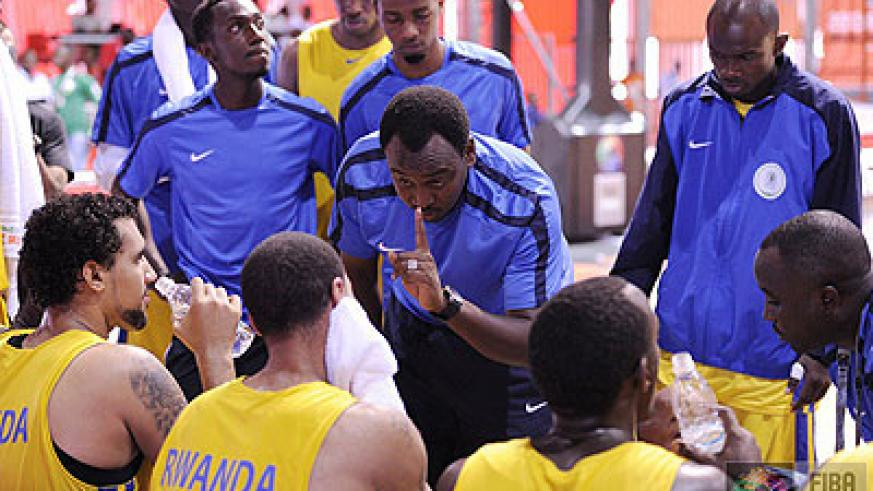Head coach Moise Mutokambali giving tips to his players at the just concluded Fifa Afrobasket championships in Ivory Coast.