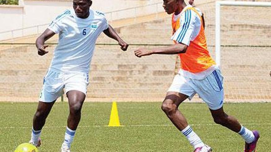 Midfielders Fabrice Twagizimana (L) and Jean-Baptiste Mugiraneza will have to be on top of their game for Amavubi to get anything out of Sunday's game. Sunday Sport/T. Kisambira