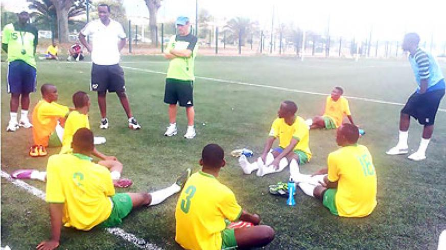 Richard Tardy (in cap) talking to his players after a training session in Nice, France recently. Times Sport / Courtesy.