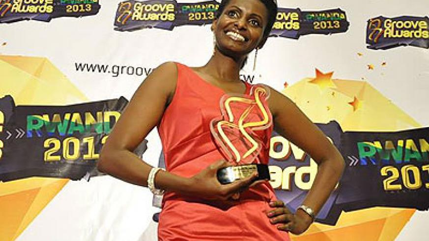 Gabby Kamanzi poses with a trophy during the launch of Groove Awards Rwanda chapter. The New Times / Susan Babijja.