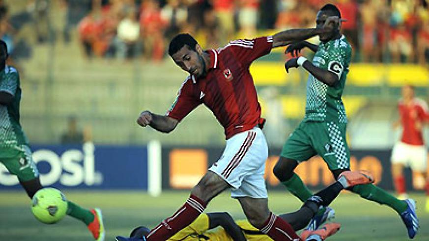 AC Leopards Goalkeeper Lawrence Ngome Ngoe (bottom) tries to defend against Egypt's Al-Ahly player Mohammed Abu Trika (C) during the first leg match. Net photo.