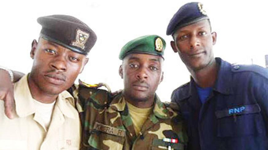 """SMS (R) with Sgt Kabera (M) and Sgt Ngoboka (L). When they come together for joint gigs, they go by the stage name of Kama Jeshi, which is Swahili for """"like a soldier"""". Sunday ...."""