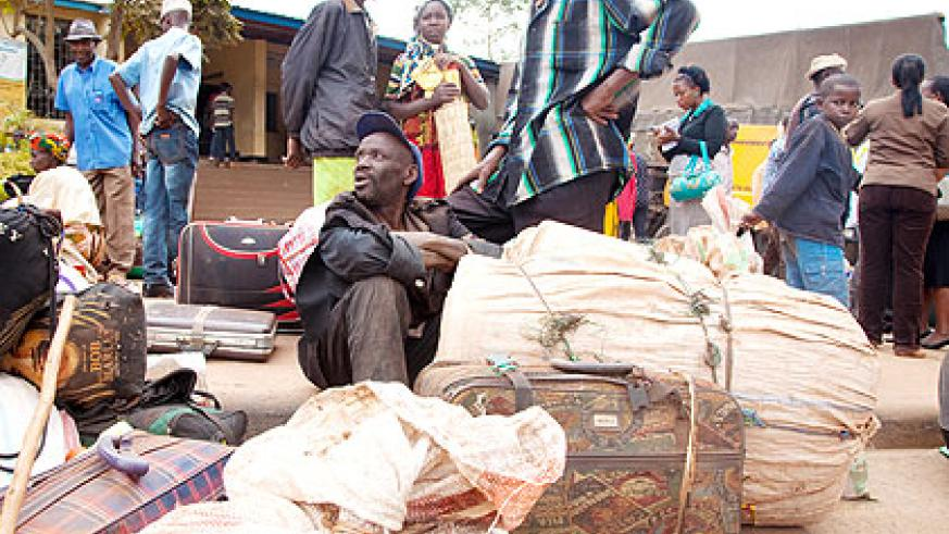 Some of the evictees from Tanzania await for assistance on arrival in the country recently. The New Times/ File.