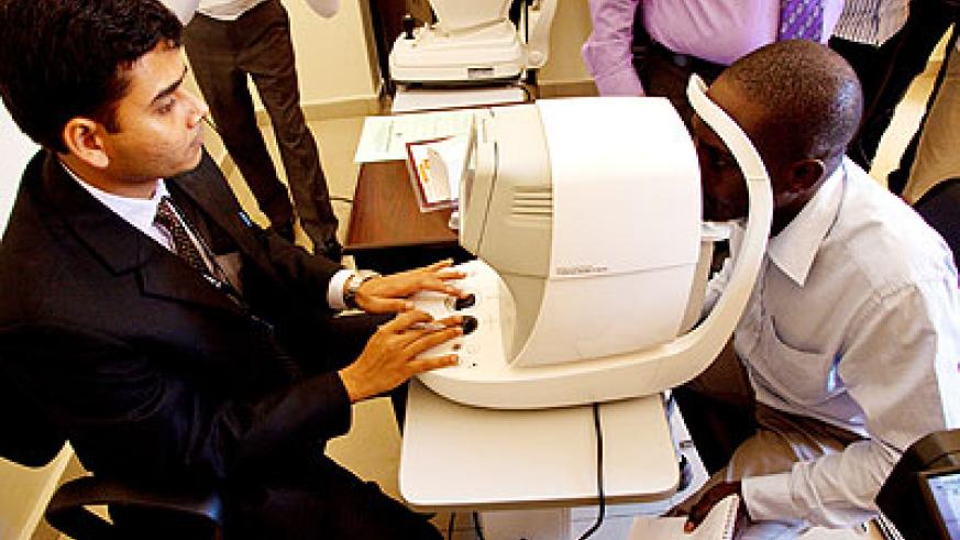 An optician checks a patient's eye at Dr Agarwal's Eye Hospital in Remera.   The New Times/ T. Kisambira.