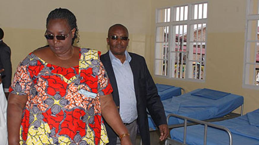 Minister Mukantabana (L) while touring the pediatrics wing at Kigeme Hospital on Monday.    The New Times/ Jean Pierre Bucyensenge