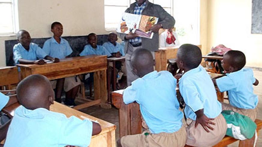 A teacher engages his pupils in a classroom. If students evaluate their teachers, many shortcomings and be fixed. The New Times/ Courtesy.