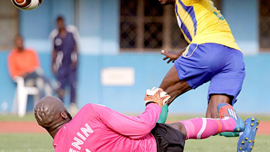 Meddie Kagere tries an audacious chip over Benin keeper during a 2014 Fifa World Cup qualifier at Amahoro stadium. Times Sport / File.
