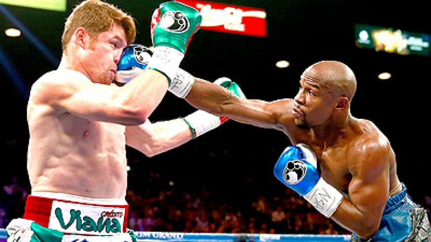 Mayweather (R) badly mistreated Saul 'Canelo' Alvarez (L) in the sport's biggest event in years.  Net photo