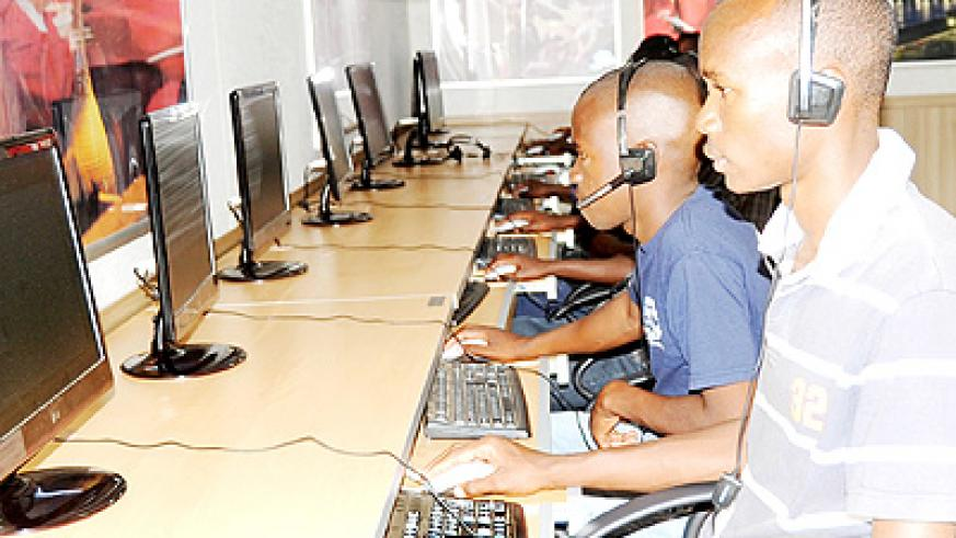 Youth use Internet at an ICT hub in Kigali. The Internet is the number one source of academic information today. The New Times/ File.