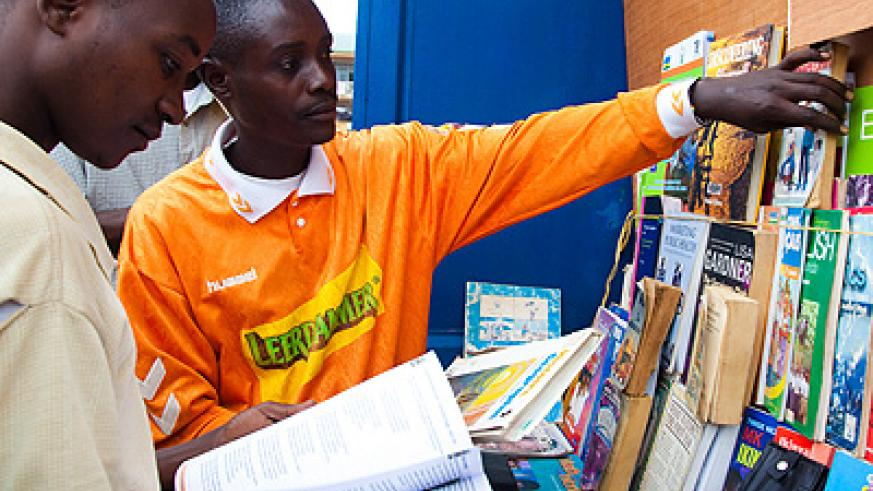 Bazambaza attends to a client in his bookstore at Nyabugogo. Despite low reading culture, he managed to pick up a trade in selling used books, mainly of lang....