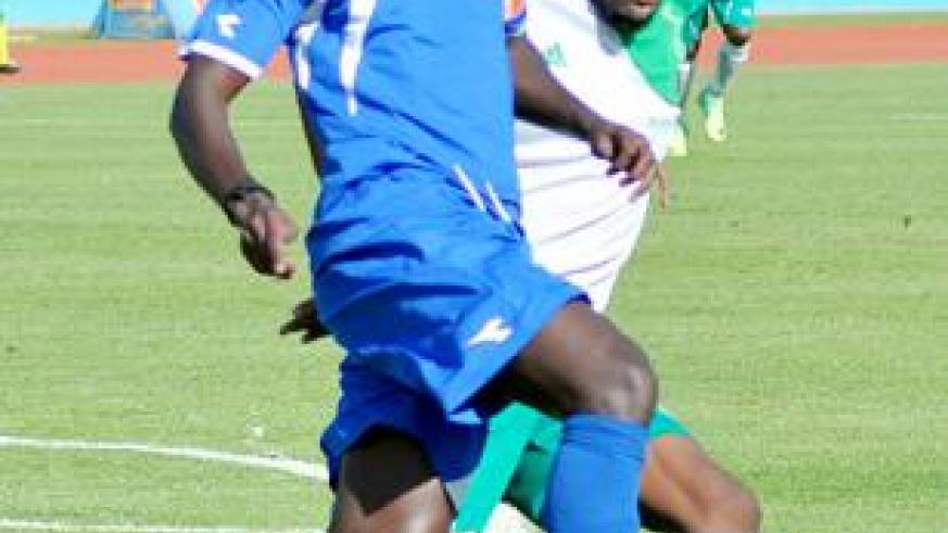 Rayon Sports midfielder Aphrodis 'Kanombe' Hategekimana  battles with a SC Kiyovu defender in a second round league clash at Amahoro stadium. Saturday Sport/ P. Muzogeye