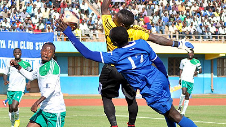 Amiss Cedric scored goals for fun last season and in one game (above) he even attempted a 'hand of god' goal against Kiyovu. Saturday Sport/ P. Muzogeye.